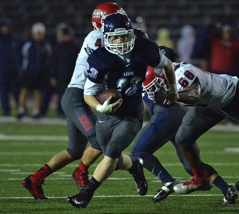 by: VERN UYETAKE - Lake Oswego running back Max Mattern breaks into the secondary in the Lakers' play-in victory over David Douglas last week. Mattern had 96 yards and a touchdown in the game.