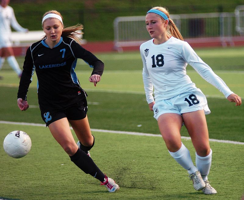 by: DAN BROOD - Lakeridge's Gen Dupre looks to win a ball aginst Tualatin during last week's 2-0 loss in the first round of the playoffs.