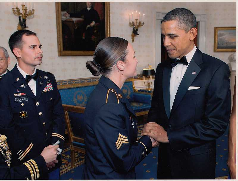 by: WHITE HOUSE PHOTO - Sgt. Sarah Adams is greeted by the president at a White House dinner honoring wounded Iraq veterans