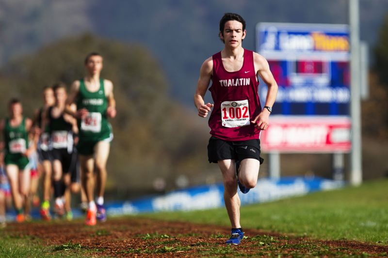by: DAVID BLAIR:FOR THE TIMES - WOLF ON THE RUN -- Tualatin sophomore Mark French keeps up the pace during the Class 6A state cross country meet.