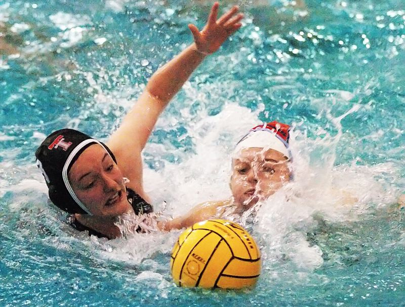 by: DAN BROOD - SPLASH ATTACK -- Tualatin sophomore Zoe Linford (left) battles a South Salem player for the ball in Friday's playoff game.