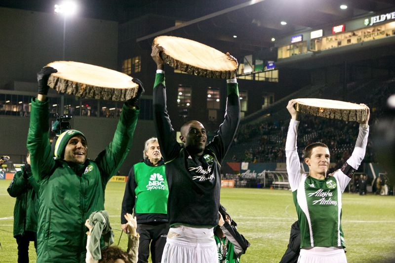 Spoils go to Portland goal scorers (from left) Diego Valeri, Mamdou 'Futt' Danso and Will Johnson.