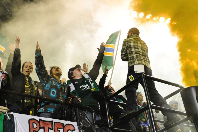 The Timbers Army revels amid colored smoke after the game.
