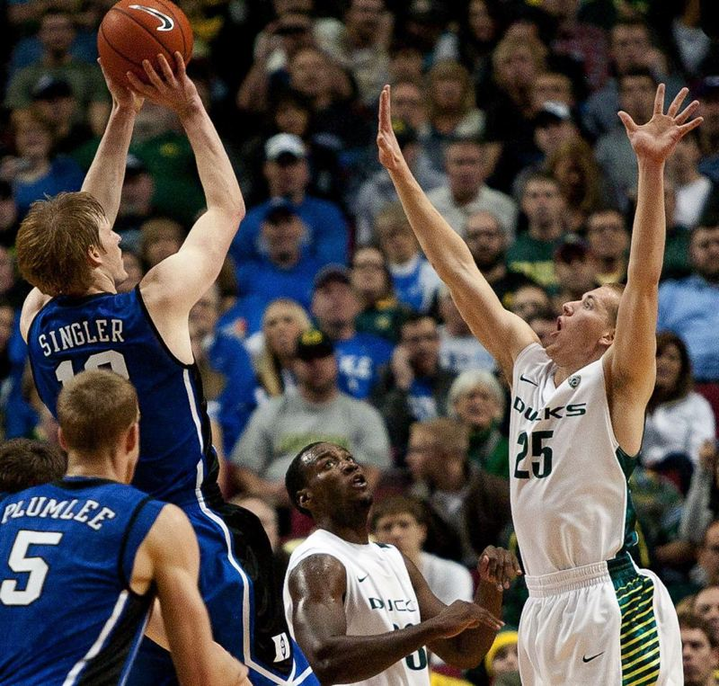 by: TRIBUNE FILE PHOTO: PATRICK COTE - Kyle Singler (left) shoots a jumper during his Duke career over brother E.J. Singler, then with the Oregon Ducks. Kyle Singler and the Detroit Pistons play Monday against the Trail Blazers.