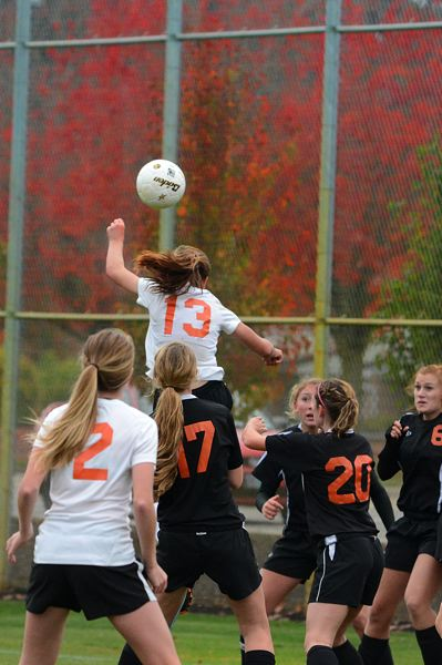 by: JOHN WILLIAM HOWARD - Natalie Muth (13) rises for a header in the first half. Muth's goal put the Indians up 2-0.
