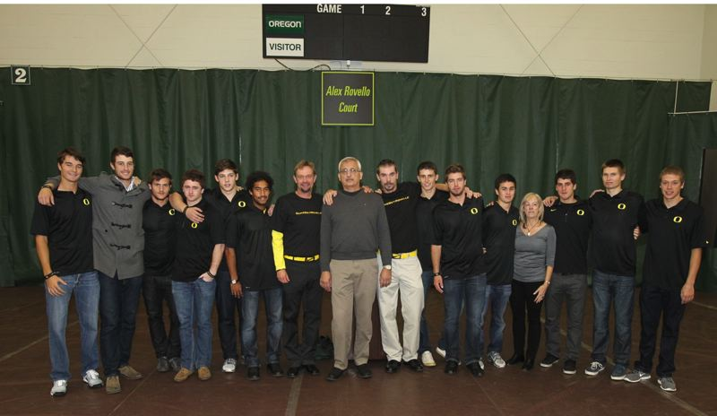 by: COURTESY OF UNIVERSITY OF OREGON - The Oregon Ducks tennis team and coaches surround Jim and Geri Rovello, parents of former Ducks star Alex Rovello, as the U of O dedicates center court at the Student Tennis Center in honor of the late prep champion from Cleveland High.