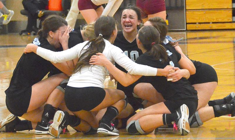 by: VERN UYETAKE - Lakeridge players celebrate after winning their first volleyball state title.