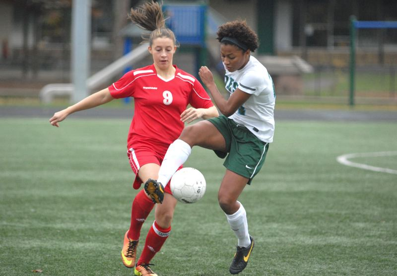 by: PAMPLIN MEDIA GROUP: DAVID BALL - Oregon Episcopal's Mickaelah McKinney-Griggs settles a ball in front of Corbett's Simone Ballard during Saturday's playoff win. She scored twice and assisted on the Aardvarks' other goal.