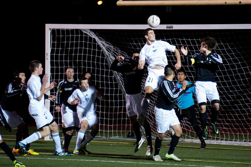 by: GREG ARTMAN - Timmy Bourque (21) skies for a header attempt Nov. 9 at Randall Stadium, where the Wilsonville boys soccer team shut out Silverton in the Class 5A state quarterfinals.
