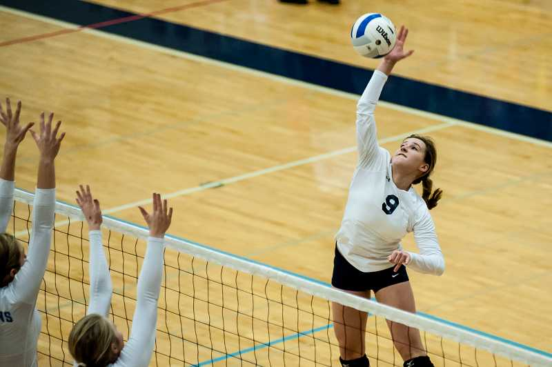by: GREG ARTMAN - Wilsonville sophomore Madi Wardle rises up at the net during the Class 5A state volleyball tournament Nov. 8-9 at Liberty High School in Hillsboro. The Wildcats came away without a trophy after four-set losses to Bend and Corvallis.