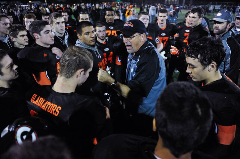 by: JOHN LARIVIERE - Gladstone coach Jon Wolf commends his players for a job well done following last Fridays drubbing of sixth-ranked Siuslaw in a first-round game of the Class 4A state playoffs.