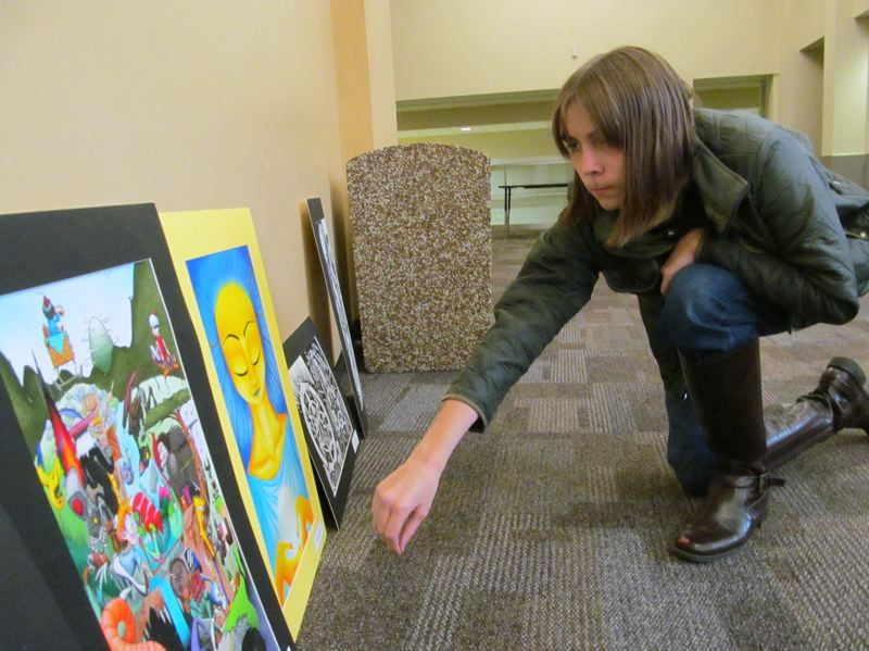 by: PHOTO BY ELLEN SPITALERI - Senior Carlie Hughes selects two of her works, 'The Grand Journey' and 'Sage,' to hang in the J.C. Lillie Center for the Arts at Milwaukie High School.