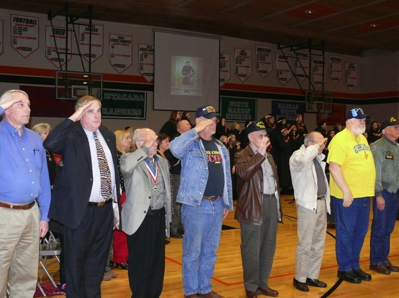 by: PHOTO COURTESY: LESLIE ROBINETTE - Gladstone veterans salute the students of at a GHS assembly on Nov. 7.