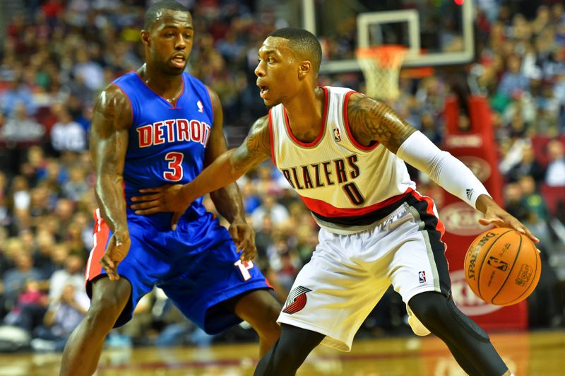 by: COURTESY OF MICHAEL WORKMAN - Trail Blazers guard Damian Lillard (right) keeps Detroit's Rodney Stuckey from coming any close in Portland's Monday night victory at Moda Center.