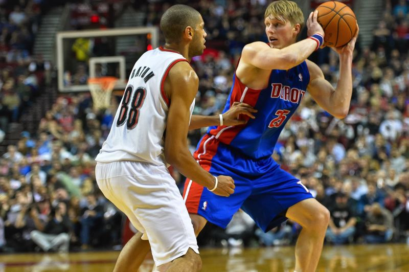 by: COURTESY OF MICHAEL WORKMAN - Detroit's Kyle Singler, from South Medford High, has Portland's Nic Batum to deal with Monday night at Moda Center.