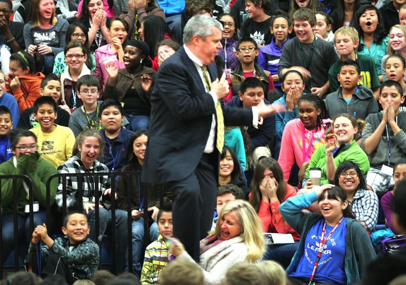 by: OUTLOOK PHOTO: JIM CLARK - Children's author Lemony Snicket stands on the lap of Walt Morey Middle School sixth grade teacher Cari Pierce during a raucous assembly at Reynolds Middle School on Thursday, Nov. 7.
