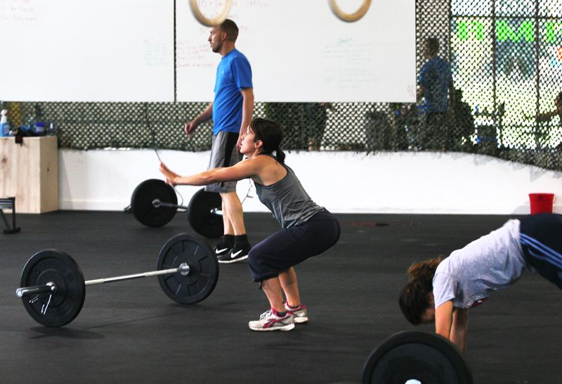 by: OUTLOOK PHOTO: JIM CLARK - At the new gym on Marine Drive, veterans and regular clients try out the CrossFit program.