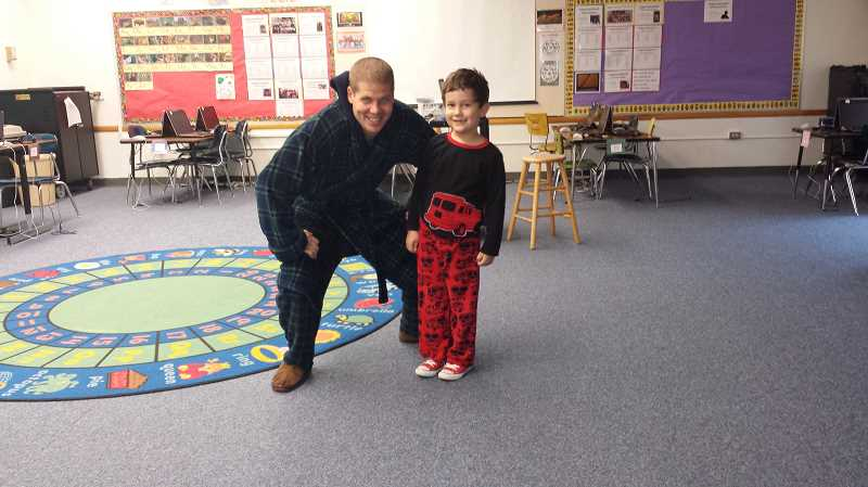 by: JUAN LARIOS - Washington Elementary School educational assistant Gevin Gregory and student Tegan Henson-Velarde model their pajamas during Red Ribbon Week.