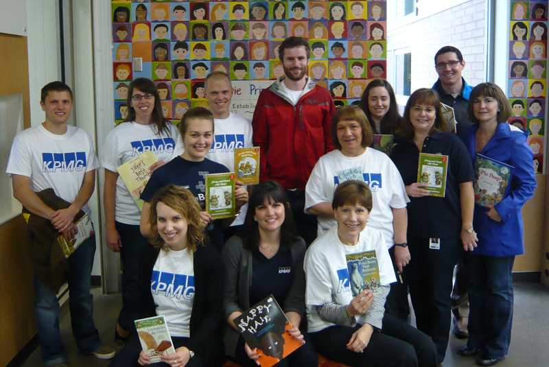 by: SUBMITTED PHOTO - Volunteers from KPMGs Families for Literacy initiative deliver 375 books to Lowrie Primary School on Oct. 30.