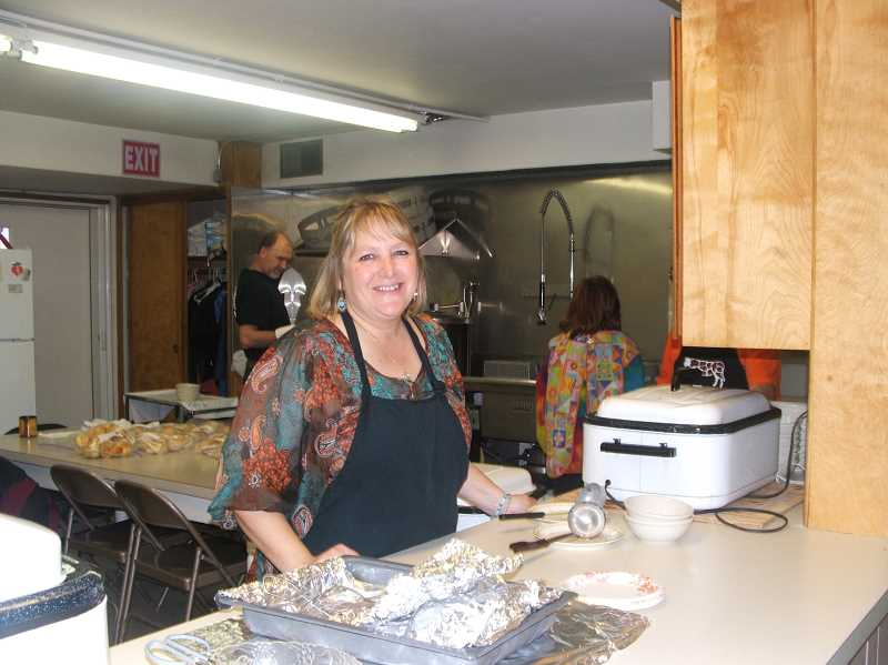 by: SUSAN VETTER - Kristi Stokley pauses from her job volunteering in the serving line at Woodburn Immanuel Lutheran Church's annual Fall Festival on Saturday.