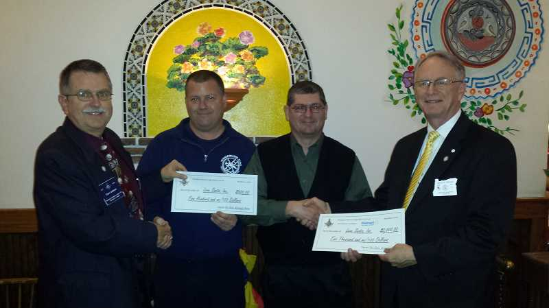 by: SUBMITTED - Pictured left to right are Don Judson, worshipful master of the Woodburn Masonic Lodge; James Audritsh II, Love Santa, Inc. board member; Robert Prinslow, president of Love Santa, Inc. board; and David H. Fryday, grand master of Ancient Free & Accepted Masons in Oregon.