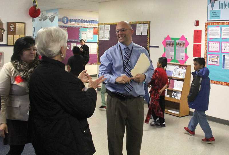 by: JEFF MCDONALD  - odd Farris, principal at Nellie Muir Elementary, discusses needed improvements that would be part of a planned $70 million Woodburn School District bond effort slated for Mays ballot. The tour brought community members into the school to look at areas of concern, including a crowded library and classroom space.