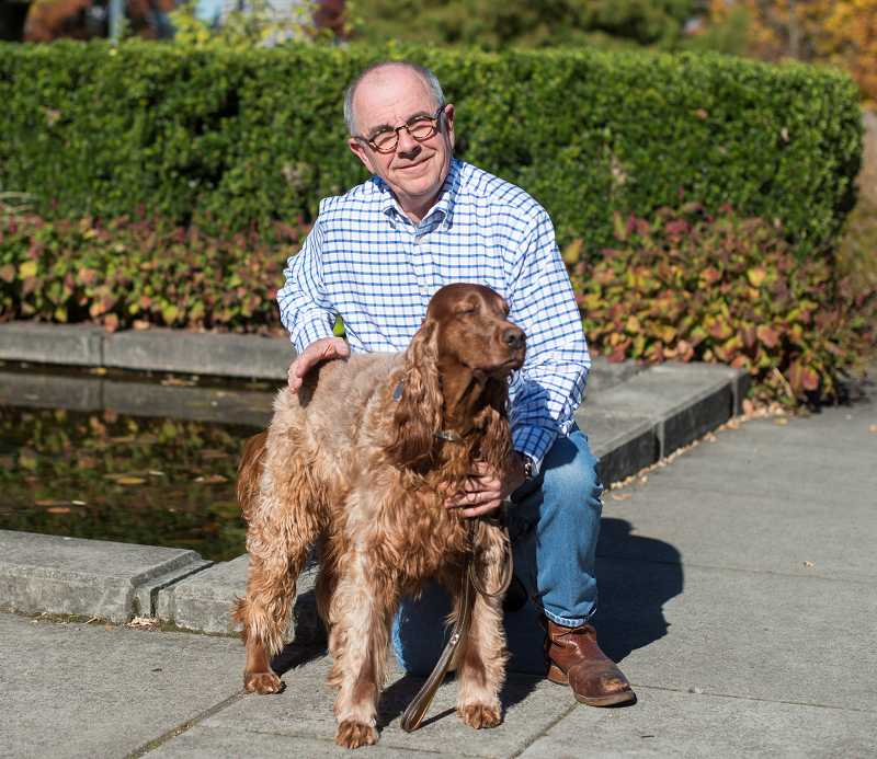 by: NEWS-TIMES PHOTO: CHASE ALLGOOD - Paul Elsner, city attorney of Forest Grove, brings his dog to his downtown Portland office, where he spoke to the News-Times about Oregon law and free expression.