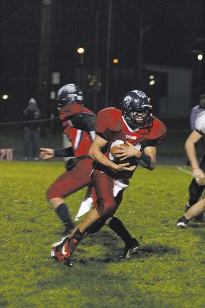 by: PHIL HAWKINS - Senior Cole Galtes received the majority of the carries in the Trojans first-round match against Oakland High School. Kennedy had little luck against the Oakers stout defense, which held the Trojans to just 22 yards on 25 carries.