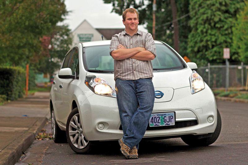 by: PAMPLIN MEDIA GROUP: JAIME VALDEZ - Andrew Catts likes the cost of opearting his Nissan Leaf EV so much that he plans to buy one for  Clackamas Service Center, a social service agency where he works.