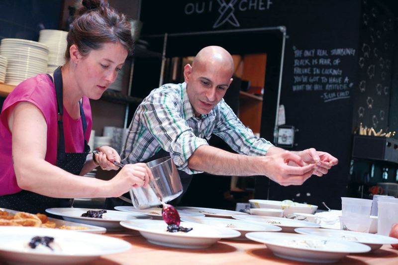 by: PAMPLIN MEDIA GROUP: JONATHAN HOUSE - Visiting Iron Chef finalist Jehangir Mehta, top right, and Beast owner/chef Naomi Pomeroy prepare a gluten-free dish during a lunch event at her restaurant last month. Patrons enjoyed the gluten-free meal, part of a Chefs Table Tour sponsored by the nonprofit Gluten-Free Resource Education Awareness Training (GREAT) Kitchens.