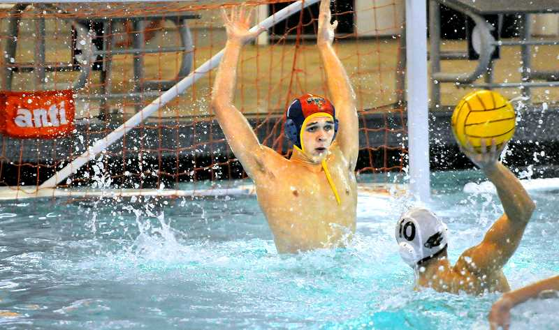 by: GARY ALLEN - NHS goalee Kyle Hansen was named to the tournament's first team after turning back numerous scoring attempts in the Tiger's 11-10 loss to Southridge in the state championship game Saturday evening at the Osborne Aquatic Center in Corvallis.