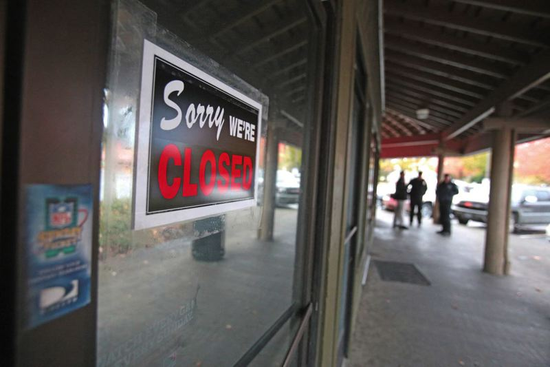 by: TRIBUNE PHOTO: JONATHAN HOUSE - A closed sign denotes one of the four lottery bars that have been shut down at Hayden Islands Lottery Row.