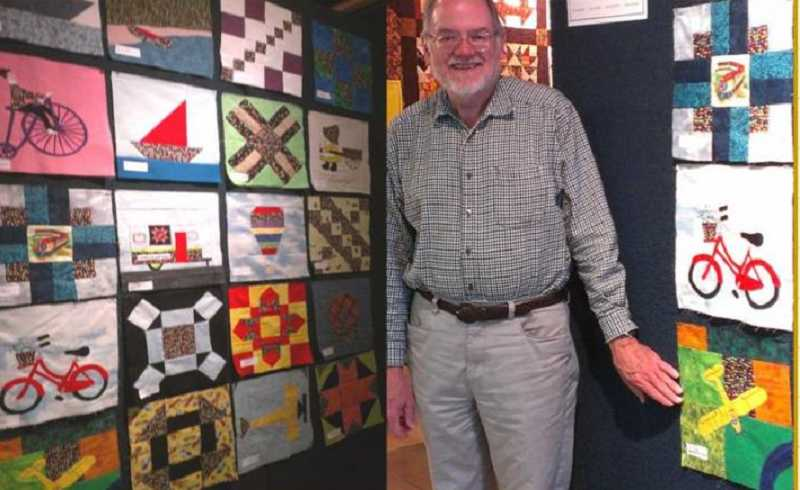 by: SUBMITTED PHOTO - Turns out, Rick Campbell is the first male quilt block winner in the history of the Old Aurora Colonty Quilt show.