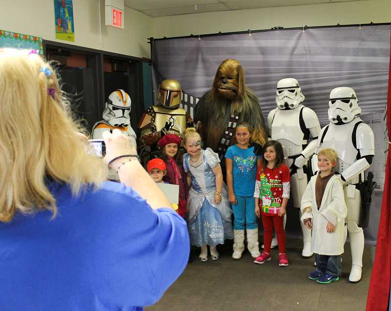 by: NEWS-TIMES PHOTOS: JOHN SCHRAG - Costumed students and staff enjoyed the annual Dilley Elementary School carnival last Saturday, participating in a Star Wars photo booth (above).
