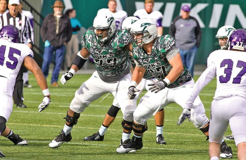 by: COURTESY OF PORTLAND STATE UNIVERSITY - Cornelius Edison (left) and Kyle Smith are two-fifths of the offensive line that, along with tight end Cam Thompson, has helped pave the way for Portland State to reassert itself as a run-first team -- and win three consecutive Big Sky games.