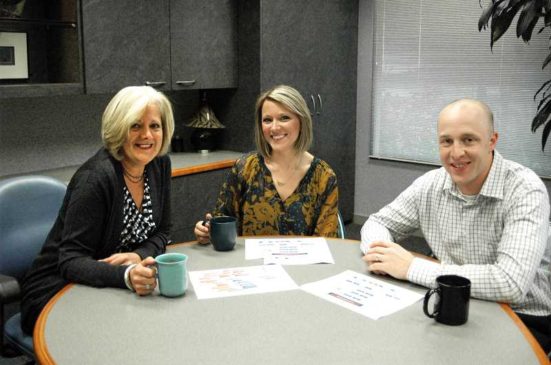 by:  ISABEL GAUTSCHI - Brenda Crosby (from left), Brooke Wheeler and Matt Day discuss the family business over coffee.