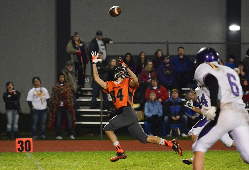 by: JOHN WILLIAM HOWARD - Scappoose junior David Krupsky reaches out to haul in a pass last Friday night. Krupsky caught three passes for 54 yards against Elmira.