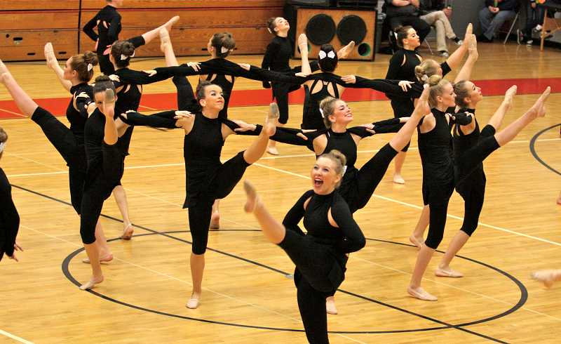 by: TIDINGS PHOTO: J. BRIAN MONIHAN - The Debs kick routine takes first place at the year's first dance competition.