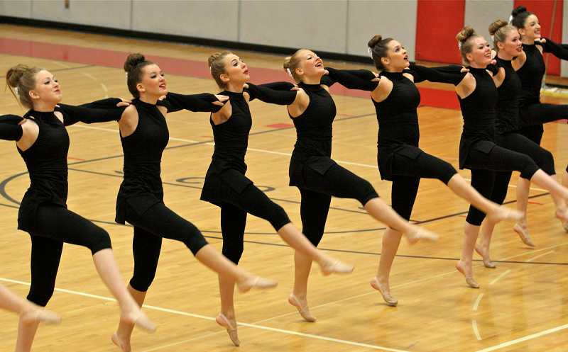 by: TIDINGS PHOTO: J. BRIAN MONIHAN - The Debs compete in the large team kick division at David Douglas High School.