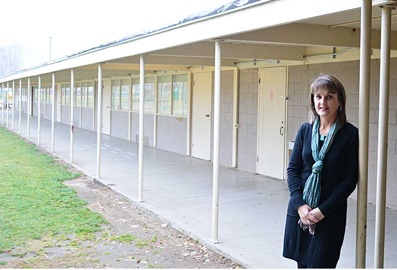 by: PHOTO BY CINDY DIX - Culver Superintendent Stefanie Garber stands next to the Culver Elementary School wing that will be demolished if the bond levy passes. The building has been deemed structurally unsafe in the event of an earthquake. Garber hopes to learn the fate of the close vote next week.
