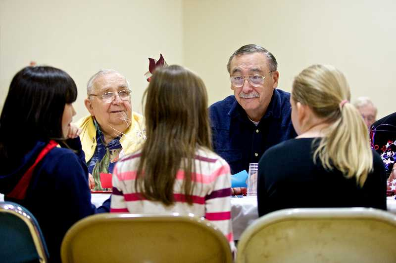 by: TIMES PHOTO: JAIME VALDEZ - Veterans Bud Dobyns and Norm Steinerj talk with fourth-graders Mallory Creech, Ava Grunow and Madison McCaw during a luncheon to honor veterans on Veterans Day at Pilgrim Lutheran School.