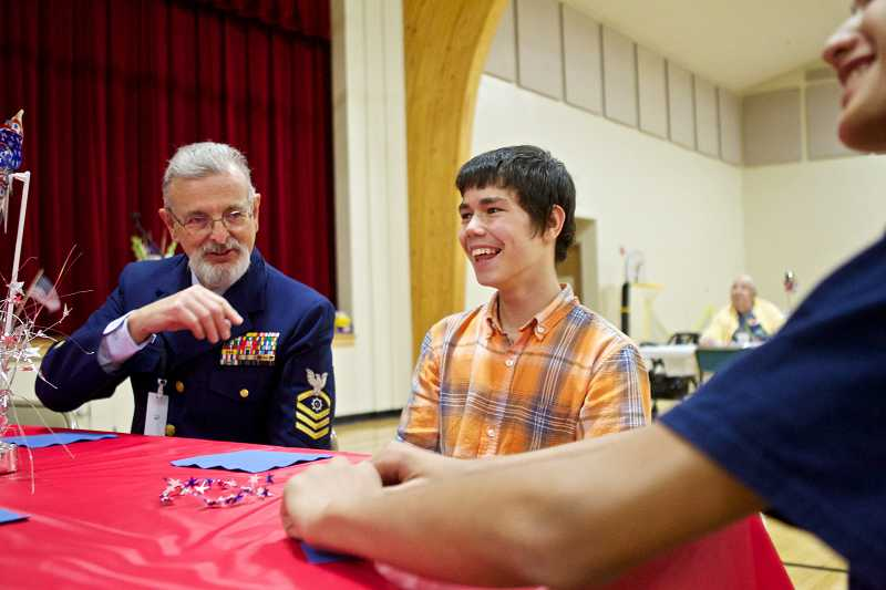 by: TIMES PHOTO: JAIME VALDEZ - Chuck Fenning, a  Coast Guard veteran, shares a laugh with Pilgrim Lutheran School seventh-graders Wyatt Ueeck and Andrew Reid.