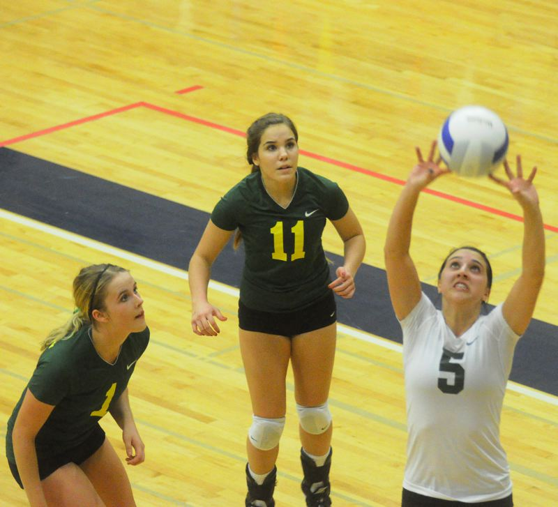 by: MATTHEW SHERMAN - Leah Beyer sets a ball during West Linn's four-set loss against No. 3 Roseburg last week.