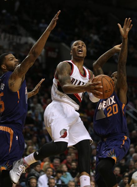 by: TRIBUNE PHOTO: JONATHAN HOUSE - Damian Lillard goes for a layup against the Phoenix Suns.