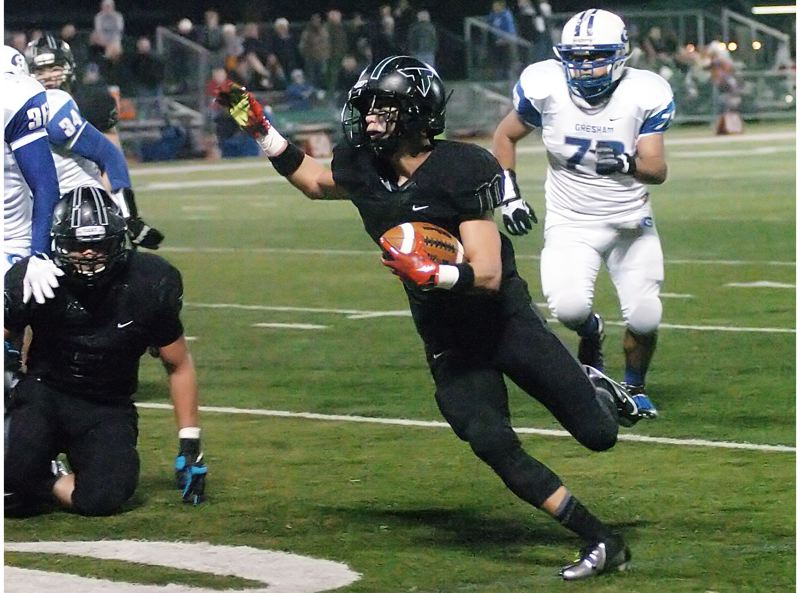by: DAN BROOD - TO THE HOUSE -- Tigard senior Manu Rasmussen heads to the end zone during Tigard's win over Gresham.