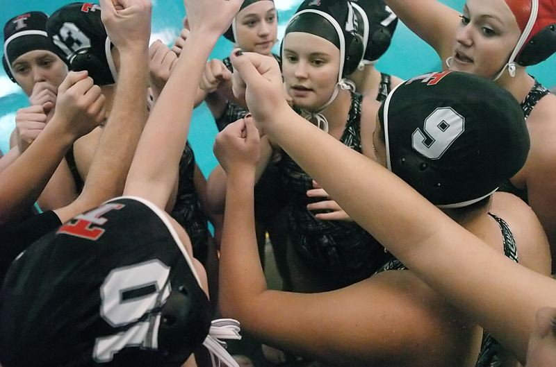 by: DAN BROOD - READY TO GO -- The Tualatin girls water polo team gathers before the start of its state championship game against Lincoln.