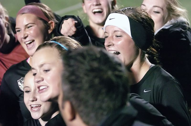by: DAN BROOD - YELLS OF JOY -- The Tualatin High School girls soccer team celebrates following its state playoff semifinal win at Jesuit on Tuesday.