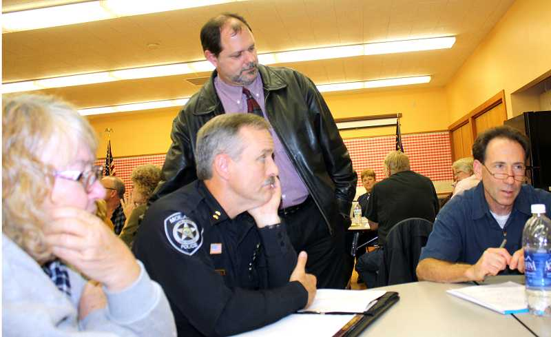 by: PEGGY SAVAGE - Alice Flintjer, Police Chief Rod Lucich, Molalla City Manager Dan Huff and Councilor Glen Boreth were some of those present at the city's Town hall to discuss proposals for use of the vacant PAL building in Molalla