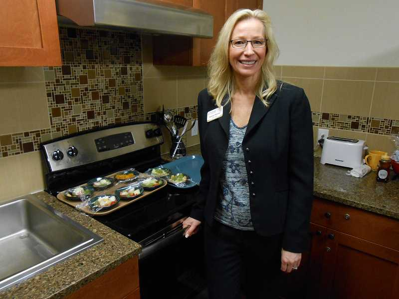 by: REVIEW PHOTO: CLIFF NEWELL - Katrina Shiroma, executive director of the Springs at Carman Oaks, is proud of the sparkling kitchen at the facilitys new memory wing.