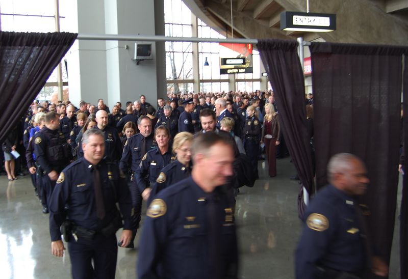 by: PHOTO BY: RAYMOND RENDLEMAN - Hundreds of police officers from across Oregon and Washington file into Memorial Coliseum on Nov. 14 to celebrate the life of a fallen OCPD reserve member.